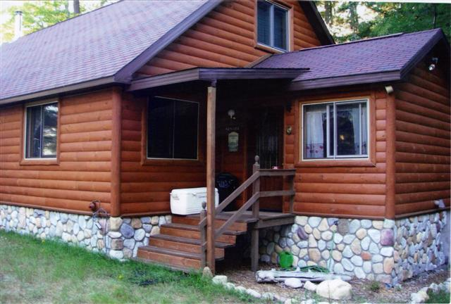 porch of darker stain log home