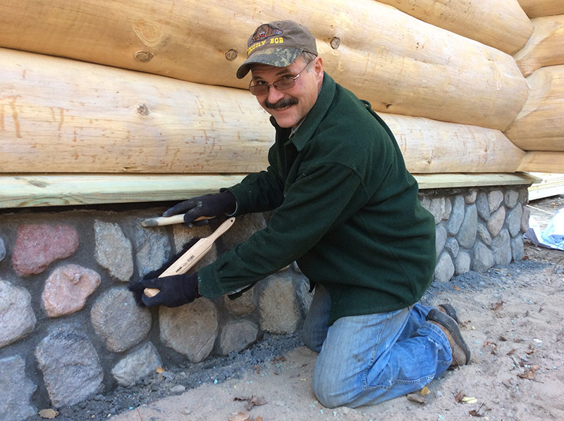 Grizzly Bob log home stone foundation finish